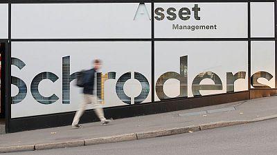British fund manager Schroders restructures business, cuts jobs