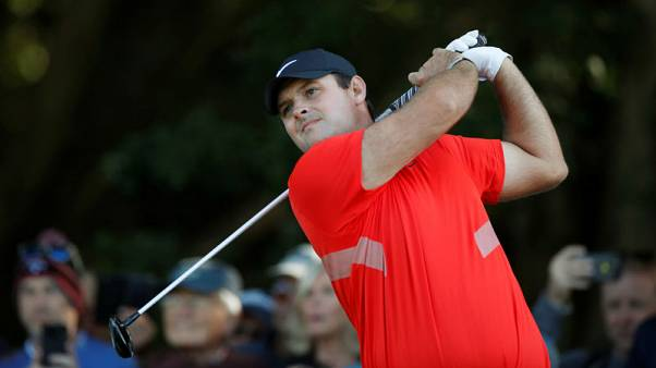 Reed, Woodland share lead in Bahamas, Woods stumbles late
