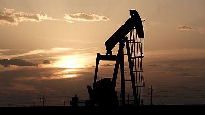 Oil steadies after price jump; investors wait on OPEC meetings