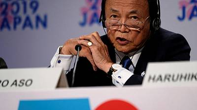 BOJ's low-rate policy not behind megabank's fee moves - Aso