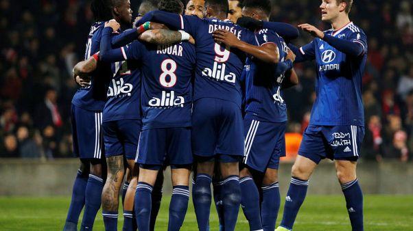 Lyon thrash nine-man Nimes to go fifth in Ligue 1