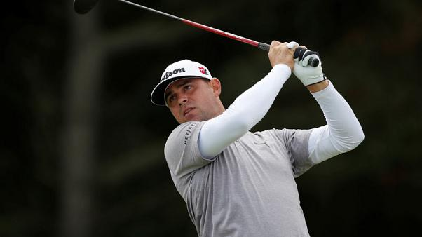 Woodland one-shot ahead at World Challenge, Woods lurks