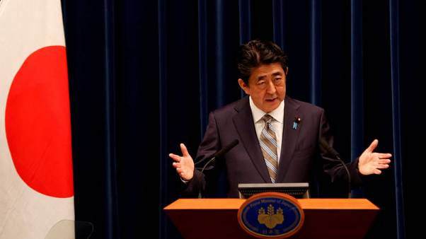 Japan PM Abe says in discussions about possible Japan visit by Iranian President Rouhani