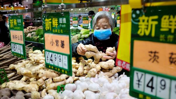 China's November PPI falls, CPI soars to near eight-year high