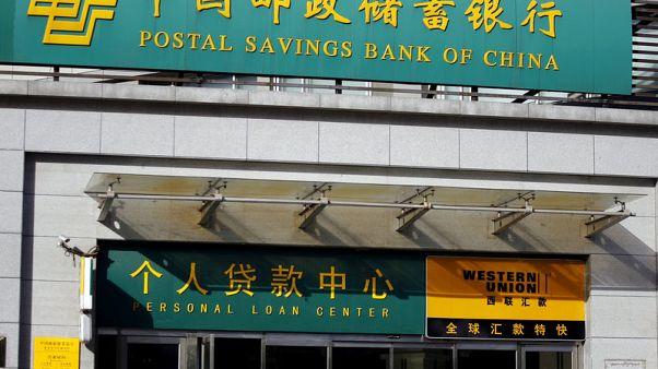China's Postal Savings Bank gains 2.7% in tepid Shanghai debut