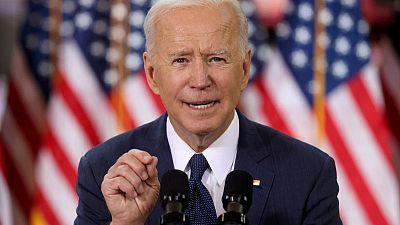 Los primeros 100 días de Biden: COVID-19, empleos, política exterior, inmigración, armas y perros