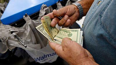 FOREX-Dólar sube levemente antes de decisión de la Fed