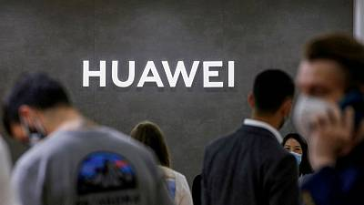 China's Huawei reports quarterly revenue drop as smartphone income hit