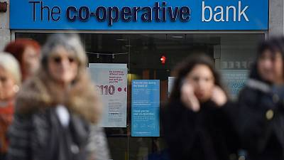 J.C. Flowers, Bain Capital Credit to buy into recovering Co-Op Bank