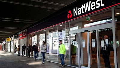 NatWest returns to profit after releasing cash for bad loans