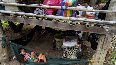 Thousands of Myanmar villagers poised to flee violence to Thailand, group says