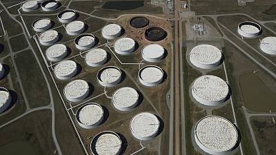Oil prices slip from six-week high, on track for monthly gains
