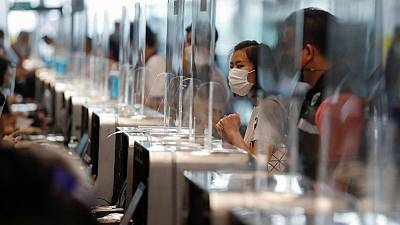 Thailand reports new daily record of 21 deaths in third virus wave