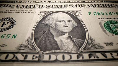 Dollar tries to build rally, eyes major euro bulwark