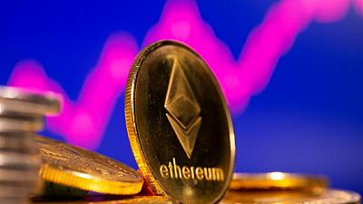 Crypto currency ether rises to new record high