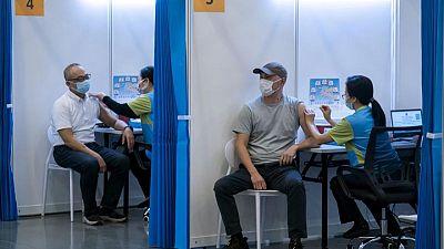Hong Kong shortens coronavirus quarantine for vaccinated residents