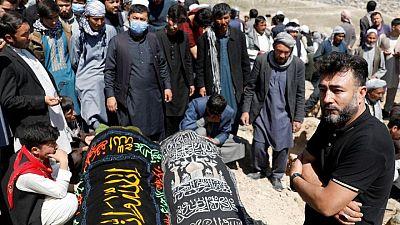 Afghan school blast toll rises to 58, families bury victims