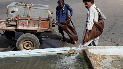 Pakistan's water bearers quench thirst in Ramadan, but fear for their trade