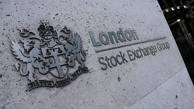 FTSE 100 rises on banks, commodity boost