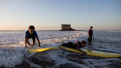 In Moroccan backwater, surfers give kids a taste of waves and freedom