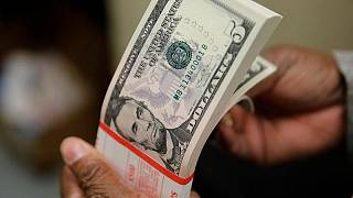 Dollar drifts lower as Fed speakers soothe inflation fears