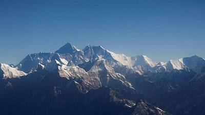 Exhaustion kills two Everest climbers, an American and a Swiss