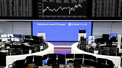 World stocks up, dollar dips as Fed officials calm inflation fears