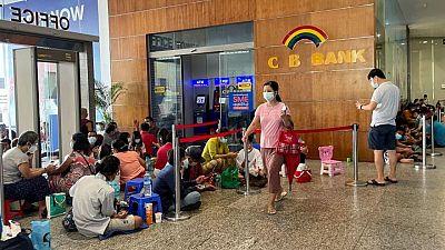 Lines, tokens and money brokers: Myanmar's crumbling economy runs low on cash