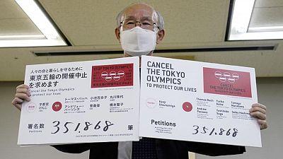 Críticos de JJOO Tokio entregan petición instando a cancelar evento