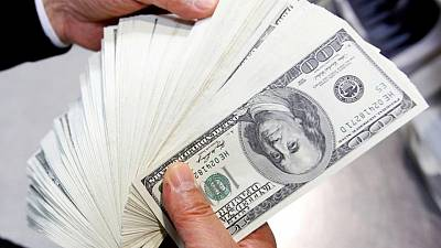 Dollar inches lower as Treasury yields hold firm