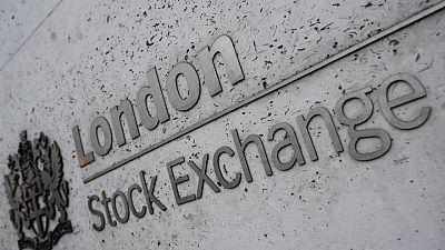 FTSE 100 rises on commodity stocks, jobs data boost; Oxford Biomedica jumps