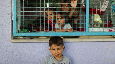 U.N. agency says 52,000 displaced in Gaza, Amnesty wants war crimes investigation