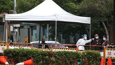 Taiwan calls for fair access to vaccines amid COVID spike
