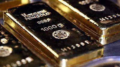 METALES PRECIOSOS-Oro repunta ante estancamiento escalada dólar
