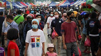 ماليزيا تعزز تمويل الرعاية الصحية لمواجهة زيادة إصابات كوفيد-19