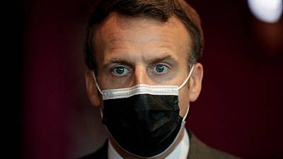 Macron calls for WHO powers to be boosted, Merkel backs call for pandemic treaty