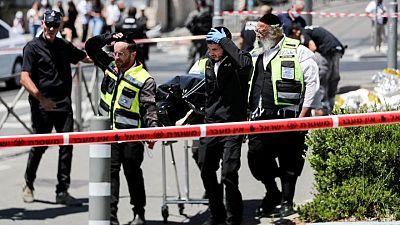 Two Israelis stabbed, assailant shot near Jerusalem flashpoint - police