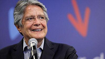 Ecuador's Lasso takes office on vows to address economic crisis