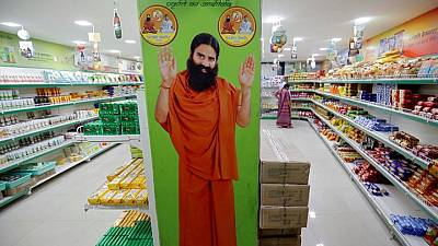 Indian doctors question plan to hand out guru's COVID-19 remedy