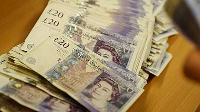 Pound highest in over a month as dollar dips on dovish Fed