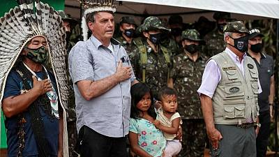 Bolsonaro visits indigenous reservations in Amazon for first time