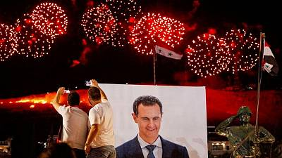 Syria's Assad tells voters they have re-defined revolution