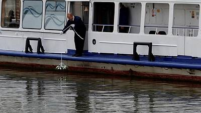 With bells and flowers, Hungary marks anniversary of Danube boat disaster