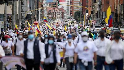 Thousands march in Colombia's Bogota to demand end to protests, roadblocks