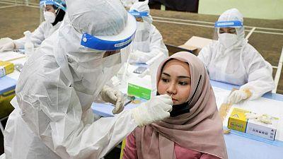 Southeast Asia's coronavirus surge prompts shutdowns and alarm