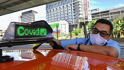 Taxi for hire! Bangkok cabbie hopes to capitalise on his COVID-19 shot