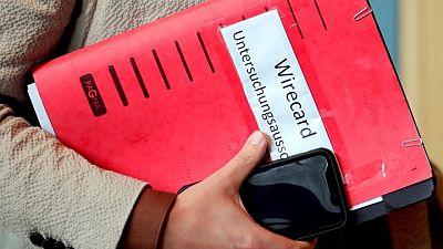 German parliament criticizes Scholz and Merkel over Wirecard - draft report