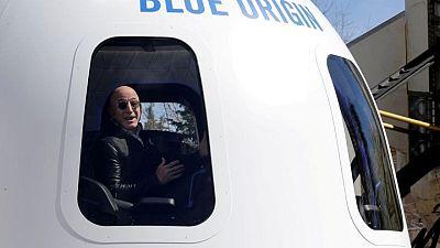 Jeff Bezos to join winner of seat on Blue Origin space flight