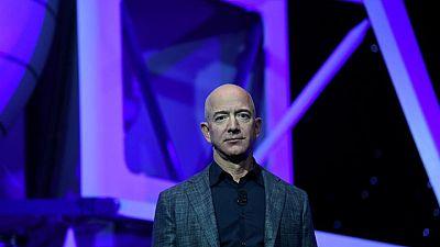 Factbox: Jeff Bezos' journey from suburban garage to edge of space