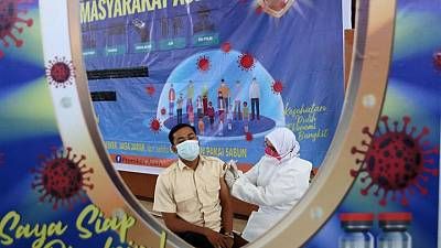 Indonesia aims to speed up vaccinations as Jakarta opens to over 18s